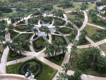 Very beautiful garden overview with geometric forms. This photo shows a very pretty garden with tropical trees and geometric forms stock photo
