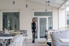 Very beautiful girl in a black dress Royalty Free Stock Images