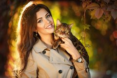 Very beautiful girl with a brown-haired woman holding a Bengal c stock images