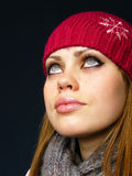 Very beautiful girl in a red cap. And a knitted scarf Stock Photos