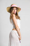 Very beautiful girl with straw hat. Looking at camera Royalty Free Stock Photography