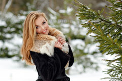 Very beautiful glamor girl in  a red collar costs about fir tree Royalty Free Stock Image