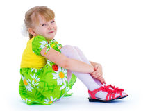 Very beautiful little girl in a green summer dress Royalty Free Stock Image