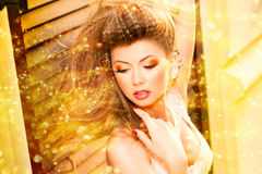 Very beautiful model wearing gold make-up stock photo