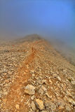 Very beautiful mountain trail in fog Stock Images