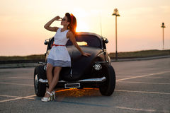 Very beautiful pin-up at sunset Royalty Free Stock Photo