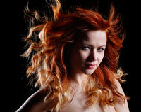 Very beautiful portrait of a woman with red hair Royalty Free Stock Images