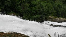 Waterfall in mountains of Norway in rainy weather. stock footage