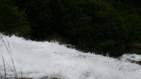Waterfall in mountains of Norway in rainy weather. stock video footage
