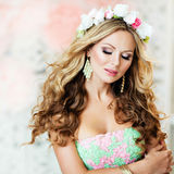 Very beautiful and sensual blonde girl with closed eyes in a lac. E dress with a wreath of flowers on his head , close up royalty free stock images