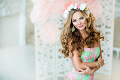 Very beautiful and sensual blonde girl in a lace dress with a wreath of flowers on his head, close up stock images