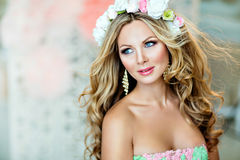 Very beautiful and sensual blonde girl with a wreath of delicate. Spring flowers, close up stock image
