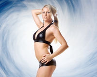 Very beautiful woman in black lingerie on blue backgroudn Stock Images