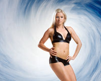 Very beautiful woman in black lingerie on blue backgroudn Royalty Free Stock Photos