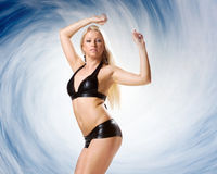 Very beautiful woman in black lingerie on blue backgroudn Stock Photos