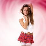 Very beautiful and sexy woman in short skirt with red background Stock Photography