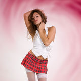 Very beautiful and sexy woman in short skirt with red background Royalty Free Stock Photo