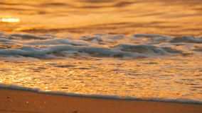 Very beautiful sunset on the seashore. Sandy beach and waves that beat on beach. Very beautiful sunset on the seashore. Sandy beach and waves that beat on the stock video