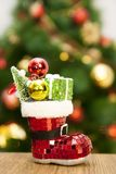 Toy on the Christmas tree with shoes. Stock Images