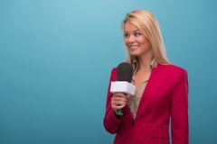 Very beautiful TV presenter royalty free stock image