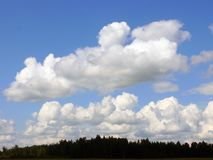 Beautiful clouds. Very beautiful varicoloured clouds on a background brightly blue sky royalty free stock photos