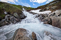 Very beautiful waterfall in Norway with fast-flowing water, big rocks with lichen summer Royalty Free Stock Image