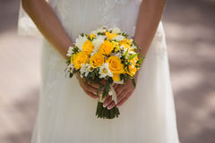 Very beautiful wedding bouquet in hands of the bride royalty free stock images