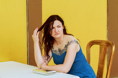 Very beautiful woman is bored alone Royalty Free Stock Photo