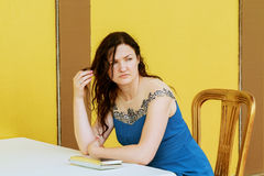 Very beautiful woman is bored alone Royalty Free Stock Photography