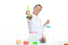 Very beautiful Woman chemist and chemicals in Royalty Free Stock Images