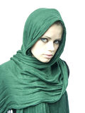 Very beautiful woman in a green linen cape. Young beautiful girl in a green linen cape Stock Images