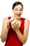 Very beautiful woman peeking inside jewelery box Royalty Free Stock Images