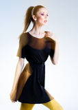 Very beautiful woman posing in black dress Stock Photos