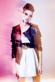 Very beautiful woman posing in a leather jacket - motion light and colors Stock Images