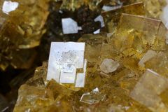 Very beautiful Yellow Fluorite with white Dolomite. Specimen of yellow, lustrous fluorite with `snow white` dolomite crystals. Top contrast from Moscona Mine royalty free stock image