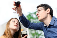 Very beautiful young couple toasting wine glasses Royalty Free Stock Image