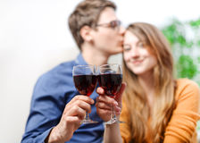 Very beautiful young couple toasting wine glasses Stock Photos