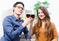 Very beautiful young couple toasting wine glasses Stock Photography