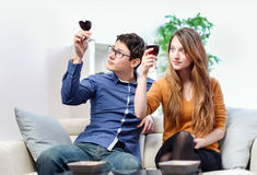 Very beautiful young couple toasting wine glasses Stock Photo