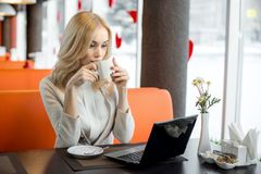 Young woman in Cafe stock photography