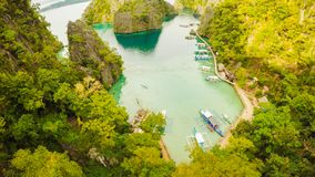 Very beautyful lagoon with boats. Paradise islands in Philippines. Kayangan Lake. Fisheye view. stock image