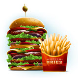 Very big cartoon style burger with fresh french fries in red ribbon box Royalty Free Stock Image