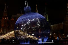 Very big Christmas ball in the colored lights in the center of M Royalty Free Stock Photography