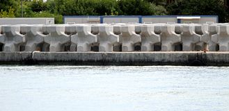 Very big concrete blocks to build a large dam in the sea Royalty Free Stock Images