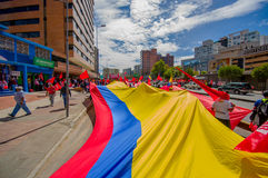 Very big Ecuadorian flag being carried through Stock Photography