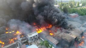 Big fire and black smoke shooting from a height