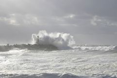 Very big wave on a blocks jetty royalty free stock photography