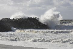 Very big wave on a concrete blocks jetty Stock Photography