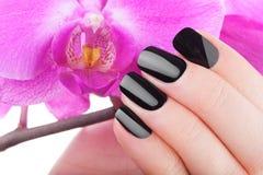 Very black nails stock photos