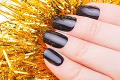 Very black nails Royalty Free Stock Photo